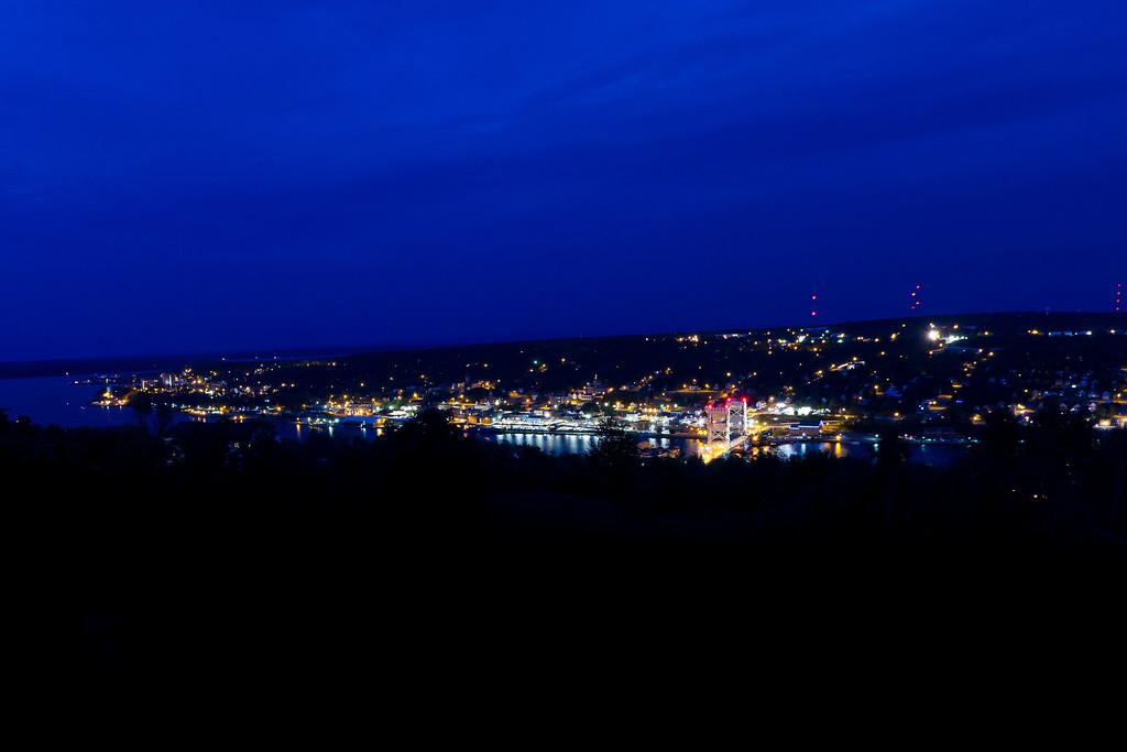The city of Houghton at 10:39 PM just before the start of Bridgefest fireworks on a unseasonably cold summer day.