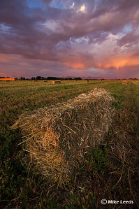 Hay field in Nampa Idaho under an evening sky in September.
