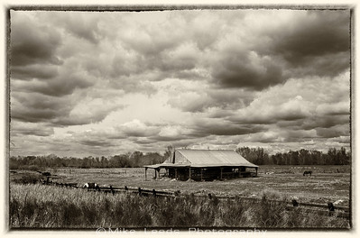Old barn near the Boise River in Idaho on a cloudy April afternoon.