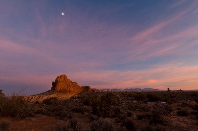 In the distance, the rising moon (two days before full) was above Ham's Rock, with the La Sal Mountains in the distance. The sky was full of color in all directions and the colors reflected off the rock forms.