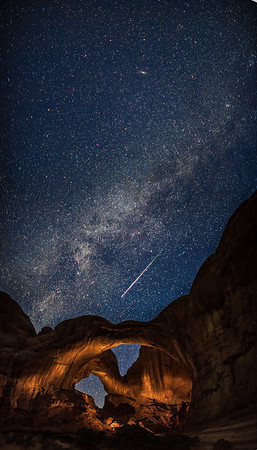 "Double Arch in Arches National Park during the Perseid Meteor Shower. The arches were lit with a flashlight in a separate exposure after i saw the meteor streak across the sky.  To purchase a print please click the ""buy"" button on the top right to add the image to the cart  Prints are available in three surface finishes. Luster is a semigloss surface, Glossy is a smooth glossy finish and Metallic is printed on a special paper with a metallic backing. The metallic paper is by far my favorite paper."