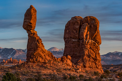 Balanced Rock and La Sal Mountains at Sunset.