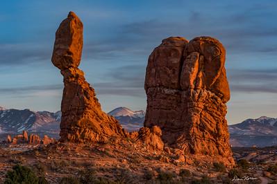 Balanced Rock and La Sal Mountains at Sunset.