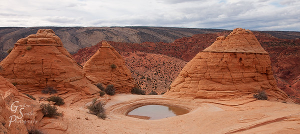 Three Teepees and Pond high on the cliffs of southern Utah.  The pond is surrounded by these teepee-shaped sandstone formation.