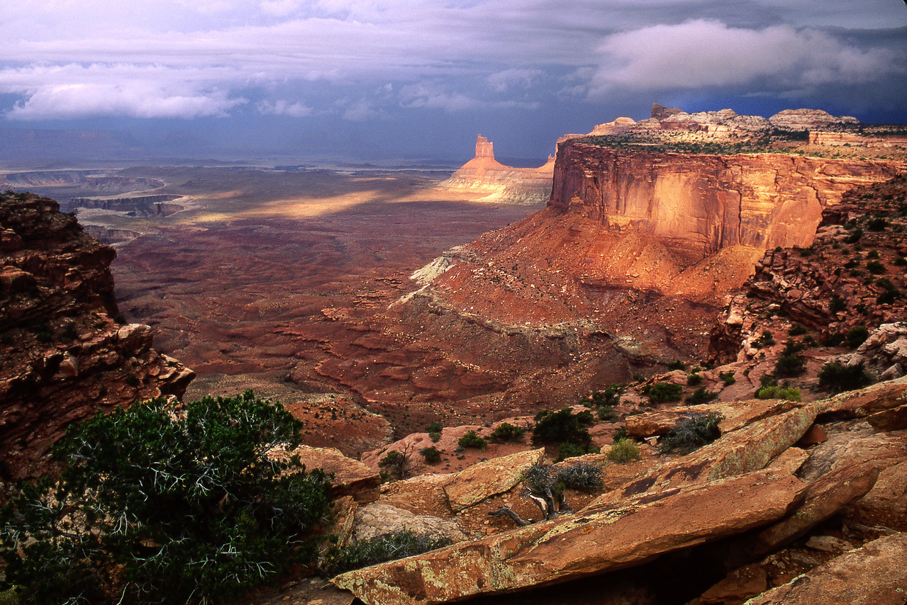 Candlestick Tower in Stormlight.  Island In The Sky, Canyonlands National Park.  Scanned from 35 mm film.