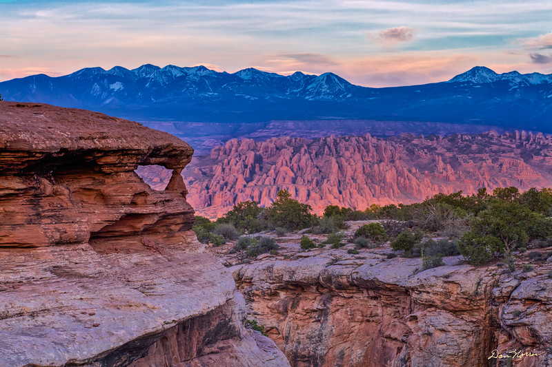 Arch on the rim of a hidden canyon