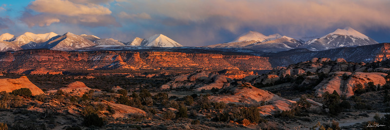 Sunset at Sand Flats Recreation Area with the snow-capped peaks of the La Sal Mountains. SandFlatsPanorama_12x36_Print