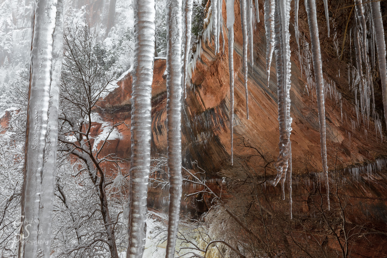 Emerald Pools winter storm with long icicles hanging from the cliff