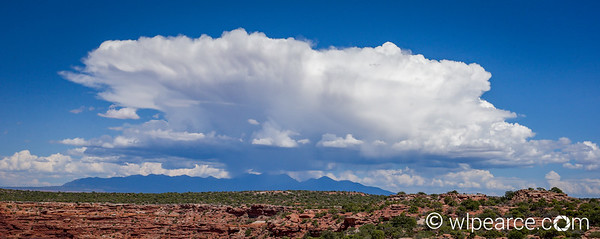 A summer thunderstorm explodes over the La Sal Range.