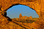 This is Sunrise at North Window in windows section, Arches National Park. The arch seen from Northern window is turret arch. This is very famous sunrise spot in arches national park.<br /> <br /> It was my first visit to arches and i was carrying #Photographing Southwest Vol1 and Vol2 books by Laurent to make sure i visit most recommended places. Initally getting to this spot to get this shot was bit difficult as it involves bit of rock climbing. Later i found better way out and it was relatively easier for me to get to this spot again in morning before sunrise.<br /> <br /> During summer sun rises from angle which cast part of this window with shadows, you need to reach this arch ~30 mins before sunset to get first light otherwise part of window will be in shadows..<br /> <br /> Photo Details:<br /> Nikon D800, Nikon 16-35 F4 @ 35mm , ISO 100, F11 1/2 sec and hand blended with another shot for sky.