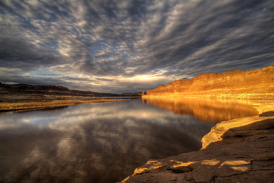 Lake Powell Sunrise  The still waters of the Colorado river mirror the red cliffs that tower above Lake Powell, Utah, USA