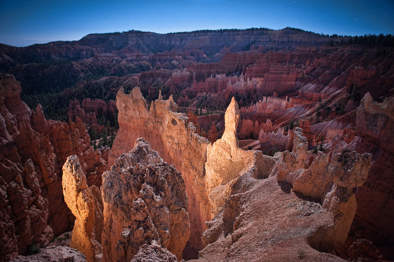 Brilliant Bryce<br /> <br /> In this night shot of the hoodoos, the difference between what is highlighted with moonlight versus light painting is obvious in its brilliant simplicity.<br /> Bryce Canyon National Park, Utah, USA