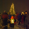 Varoy 1. of December - the official christmas tree is lit, and people celebrate the day, singing christmas carols and dancing round the tree. Heavy gusts of wind try to blow the tree over, but it is well bardunated...
