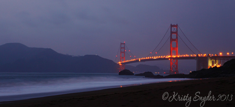 Later the same night..  we were at Baker Beach and it was raining pretty good.  Pretty comical, my sisters and I walking down the bluffs in high-heel boots because we hadn't planned to...   camera on tripod being safely covered by the umbrella....   hahaha..  we were pretty wet when we got out of there.    <br /> <br /> The rain made for not very good photos though..  I think the water interfered with the sharpness with my slow shutter speed...  Oh well...  it was fun anyway...