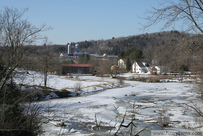 Another view of East Fairfield in winter, with the frozen creek.
