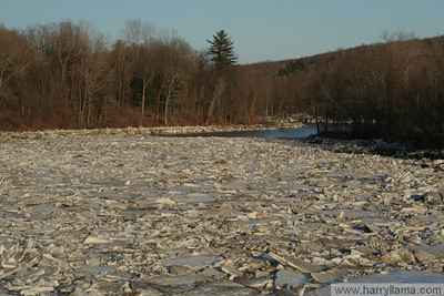 The Lamoille River in Georgia, Vermont during the spring thaw, with a buildup of fractured ice.