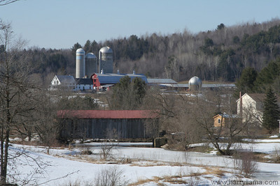 The little town of East Fairfield in winter, with covered bridge and grain silos.  This is the center of town!