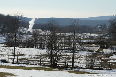 A view of the Howrigan farm and sugarhouse on Howrigan Road in East Fairfield.  The steam escaping from the sugarhouse shows that they're boiling down the sap to make maple syrup!