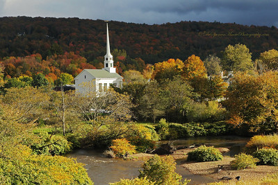 "Stowe Vermont Church in the fall with a hole in the clouds and the sun shining down on the valley at the church. ""God Light"" is what I call this."