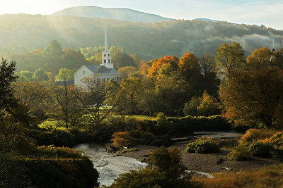 Morning fog at the Stowe Vermont Church in the fall.
