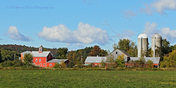 I thought this  panoramic shot of a farm was beautiful, especially with the clouds in the background.