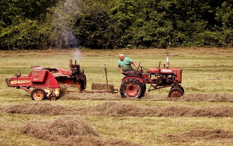 Tractor and farmer making hay in Vermont