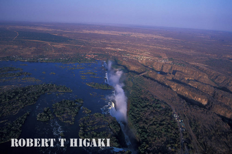 Flying in a helicoptor; very wide waterfall; very wet place-