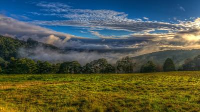 Rolling Fog at Sunrise