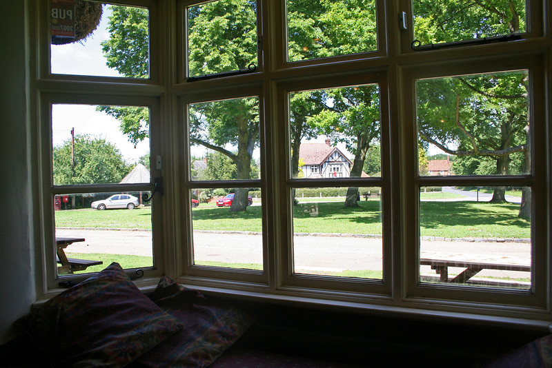 The Village Green at Preston, Hertfordshire, seen from the bar of The Red Lion.  Many pubs in England are closing, so the local Residents bought The Red Lion and run it as a co-operative.