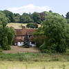 Cottage at Water End near Hemel Hempstead in Hertfordshire.  The footbridge crosses a chalk stream called the River Gade.