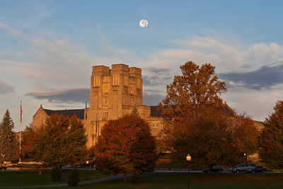 The moon sets over Burruss Hall on a Sunday morning.
