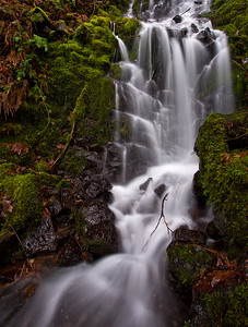 One of the hundreds of seasonal creeks that only run after heavy rains pours down the steep slopes of the canyon walls into the Little White salmon river in the Columbia River Gorge in southwest Washington.