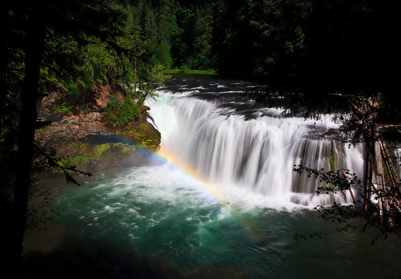 A rainbow at the base of Lower falls on the Lewis river Gifford Pinchot national forest Washington.