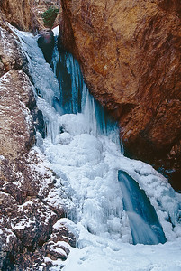 Hidden Falls in Big Cottonwood Canyon partially frozen in winter