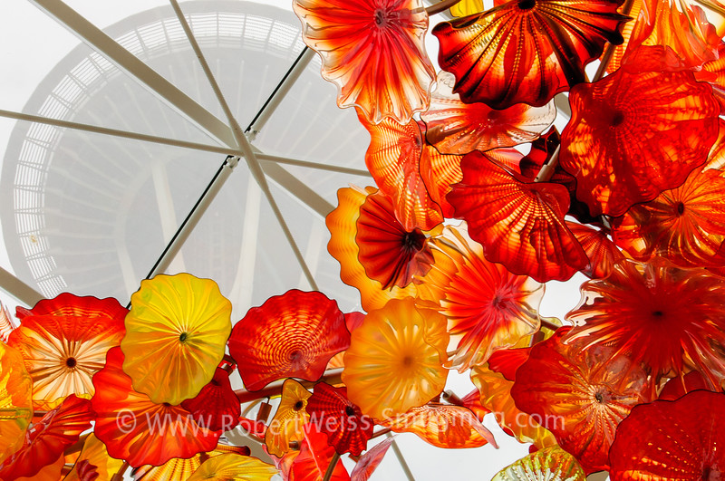 Seattle Space Needle as seen from the atrium of the Chihuly Garden and Glass exhibit.