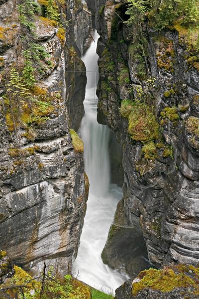 Waterfall in Narrow Canyon,<br /> Maligne Canyon,<br /> Jasper National Park, Alberta, Canada