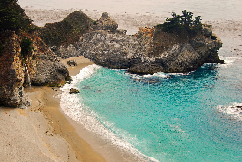 This is a photograph of a waterfall on the beaches of Big Sur, CA.