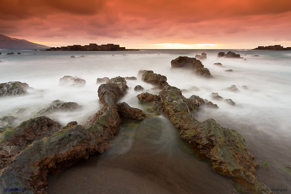Volcanic Coast and a Red Dawn. Los Cancajos, La Palma island, Canary Islands. Spain.