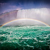 Niagara Falls with a rainbow.