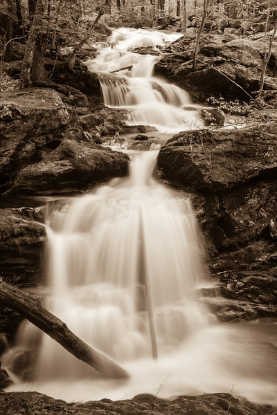 Garwin falls in sepia - well part of them.  I was up on a little ledge between trees with the tripod crazily straddling a pile of branches and a rock.  Oy.  But when I saw Jeff Newcomer's composition and the fact that there were no longer huge branches in the falls like the last time I was there, I had to give this vew a try.  I changed it to sepia because I didn't want to copy him exactly and because I don't often use it and think it suits this cascade pretty well.