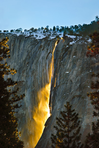 """""""Nature's Firefall"""" is a rare photograph of Horsetail Falls in Yosemite at Sunset in winter by John Harrison, <a href=""""http://www.jharrisonphoto.com"""">http://www.jharrisonphoto.com</a>. This is nature's version of the old man-made Yosemite Fire Fall.During the winter in Yosemite, coming off of El Capitan, there is an almost non-existent waterfall called """"Horsetail Falls."""" Many maps don't even have it marked. During the last two weeks in February, IF there is water trickling over the edge, and IF it is clear at sunset (which doesn't happen too often due to the winter storms) the setting sun will turn this waterfall into a stream of molten fire. The waterfall lights up like molten lava due to the angle of the sun. Inspired by Galen Rowell, many photographers have chased this elusive photo opportunity. John spent two evenings in a foot of snow in the middle of meadow trying to get the shot. The first evening was an absolute bust as it had been clear all day and at sunset the clouds hung over the peak. Luckily he captured his photograph titled """"Full Moon over Half Dome"""". The next evening everything worked out for this stunning shot."""
