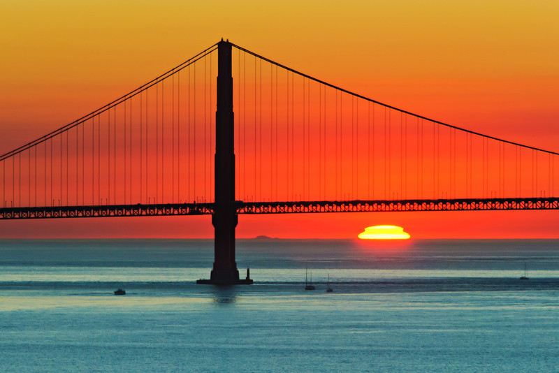 """""""Golden Gate Bridge at Sunset"""" Captured at Sunset from Alcatraz in San Francisco. Nothing like a warm sunset with the sun going down."""