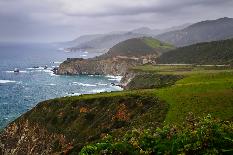 Bixby Bridge at Big Sur.  This is one of those shots of the California coastline that reminds me why I love to be here.  Rolling hills, the ocean and a beautiful curved bridge.  This is just North of Big Sur and is a definite place to stop and get some pictures.  Fog often shrouds the coastline and winter storms are dramatic crashing on the rocks below.  Enjoy!  John