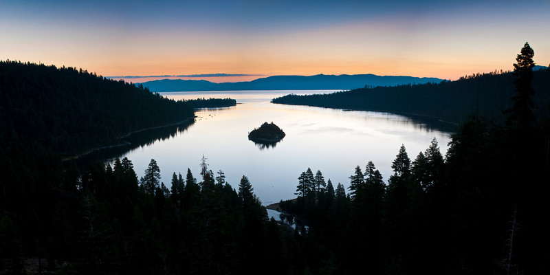 """Emerald Bay in Lake Tahoe at Sunrise"" This is a panorama shot before the sun was coming up in Emerald Bay. The silhouette of the trees and just a hint of color on the horizon. This will look good in my office as a 20x40 image! Just a note - the Eagle Falls picture from last week is also in Emerald Bay."