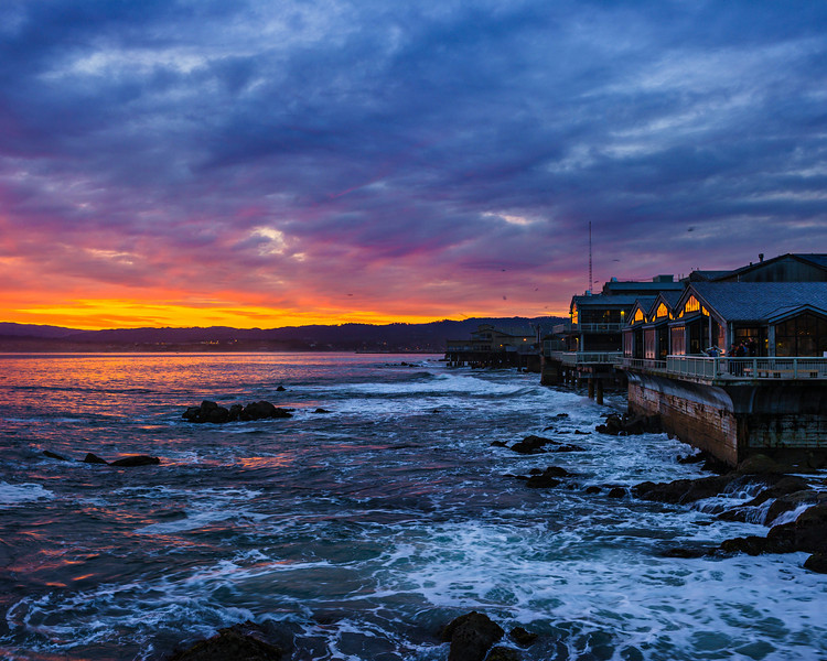 """""""Sunrise by the Monterey Bay Aquarium""""  I spent the night at the Monterey Bay Aquarium with my daughter and woke up to an amazing sunrise!  It was fantastic to just walk outside the Monterey Bay Aquarium and see such an amazing glow in the sky.  The sunlight reflected on the other building along Cannery Row catching the sunlight coming up over the hills.  Just another amazing place here in the San Francisco Bay Area."""