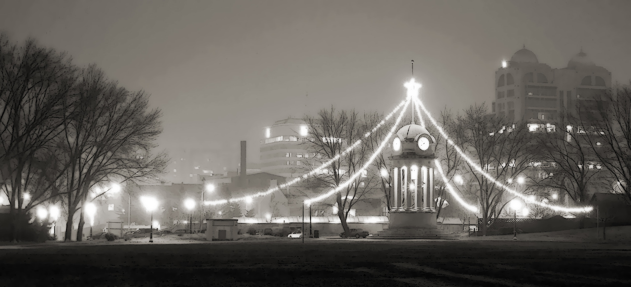 """Kitchener Clock Tower, at Christmas""<br /> The clock tower in Victoria Park, decked out for Christmas 2005 with ropes of light and stars, on a foggy evening.  Kitchener, Ontario.<br /> Image # AK35"