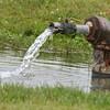 water pumping through an artisian well