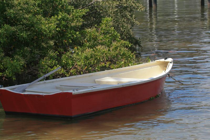 Small fishing boat tied up at a fishing village on Pine Island Sound near Captiva, Florida.