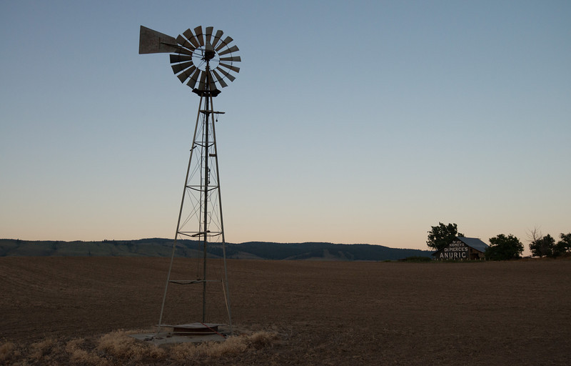 Old barn and windmill at dawn
