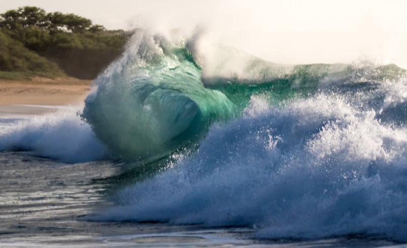 A massive winter wave breaks on Popahaku Beach, Molokai, Hawaii.